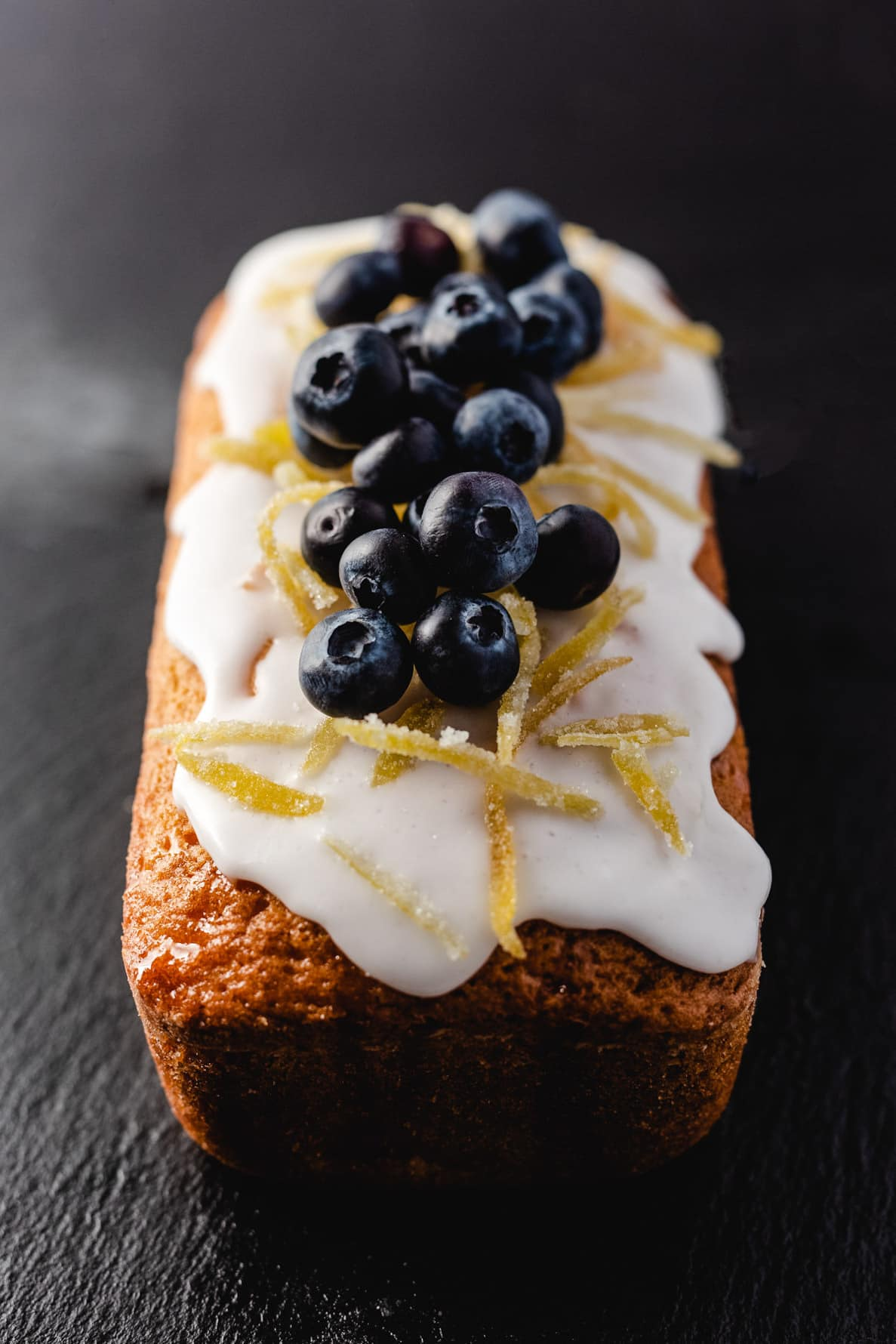 lemon drizzle cake topped with blueberries