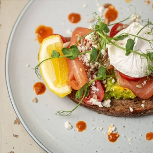 poached egg and salmon on rye bread toast food photography