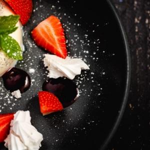 Vanilla Panna Cotta served with fresh Rutland strawberries, meringue shards and raspberry coulis