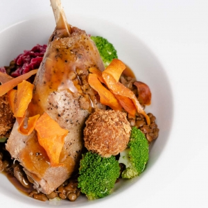 Slow cooked duck leg - duck and sloe gin bon bons, braised red cabbage, broccoli and a rich lentil cassoulet