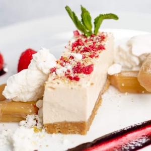 Rhubarb and custard cheesecake - poached rhubarb and meringue shards