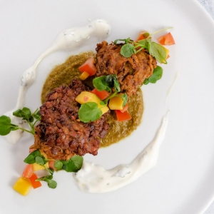 Onion Bhaji - Lentil fritters, dhal, coriander & lime yoghurt with tomato concasse